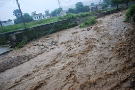 Bus stand turned into river